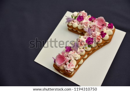 Number Seven Cake Cream Tart Decorated With Flowers And Candies