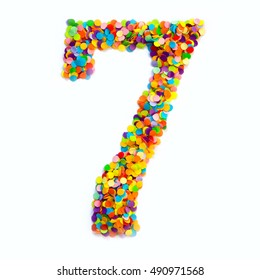The number seven is lined with colored confetti. White background