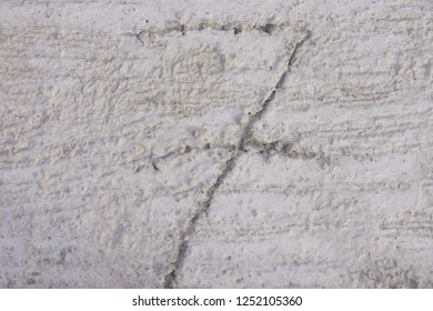 Number seven scratched on precast concrete