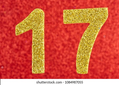 Number seventeen golden color over a red background. Anniversary. Horizontal