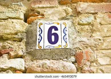Number six in a ceramic tile on street