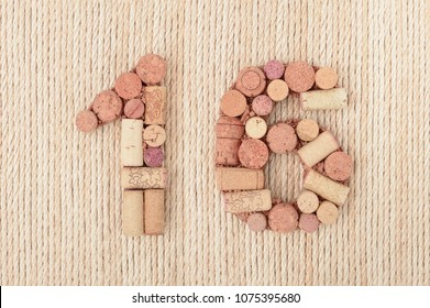 Number  sixteen 16  made of wine corks on sea ropes background