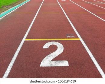 The number at start point of running track or athlete track in stadium (2). Running track is a rubberized artificial running surface for track and field athletics.