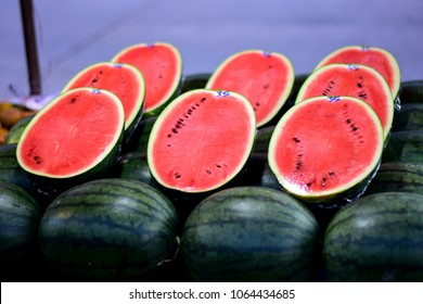 number of sweet water melon, some cut half