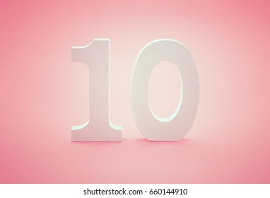 Number ten (10) on pink background. Conceptual image.