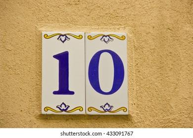 Number ten in a ceramic tile on street