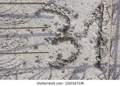 Number thirty-one scratched on precast concrete