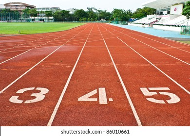 Number three  four and five on the start of a running track
