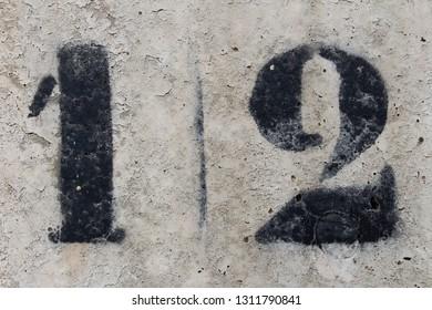 number twelve painted stencil on concrete wall, number twelve