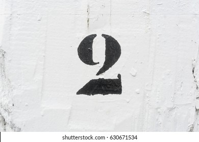 number two (2) template painted on a white background