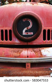 Number two on the front of an abandoned fire truck