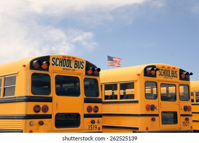 Number of typical American school busses in a row in the desert near Albuqerque, New Mexico