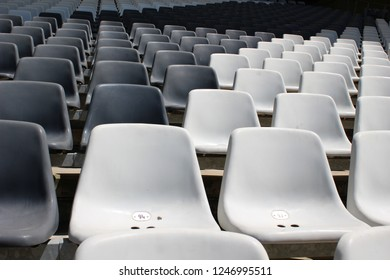 Numbered chairs inside arena