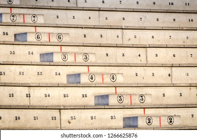 Numbered concrete stands or bleachers distributed in rows and columns for audience or spectators