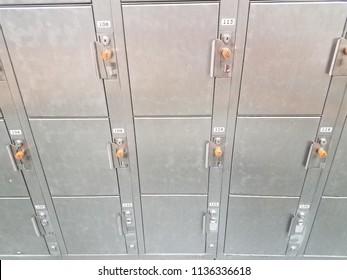 numbered metal lockers with orange keys