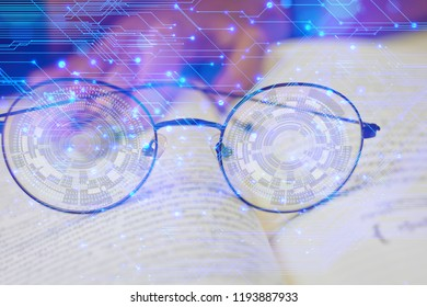 Numbers 0 and 1 in front of the lens of the glasses. eyeglasses are on the book. People's hands blurred background. concept: read,sight,myopic,
