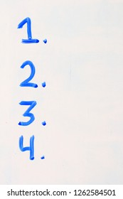 the numbers 1 2 3 4 listed on a white board in blue with copy space