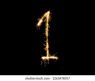Numbers 1 or one Sparkler firework light isolated on black background.
