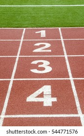 The numbers 1,2,3 and 4  on race track in football stadium.