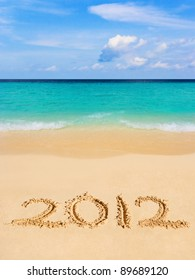 Numbers 2012 on beach - concept holiday background