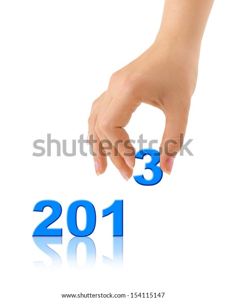 Numbers 2013 and hand isolated on white background