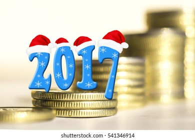 The numbers 2017 in the background of bars coins . The concept of financial stability in the new year .