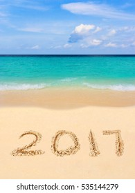 Numbers 2017 on beach - concept holiday background