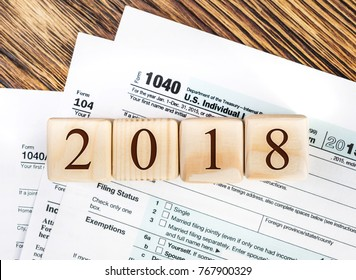 Numbers 2018 on the tax forms 1040. Business and tax concept. Pay tax in 2018 years.