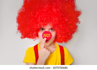 Numbers 2021 on the red nose of a clown. Holidays, party, concept. New year is coming. 1 April.