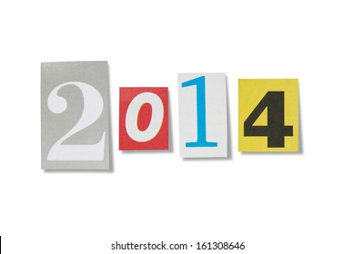 Numbers cut out from magazines spelling the year 2014, isolated on white with path