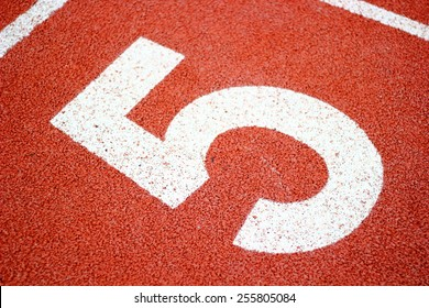Numbers five on  running track.