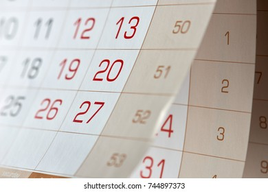 numbers on an annual, quarterly, large calendar that is opened and suspended