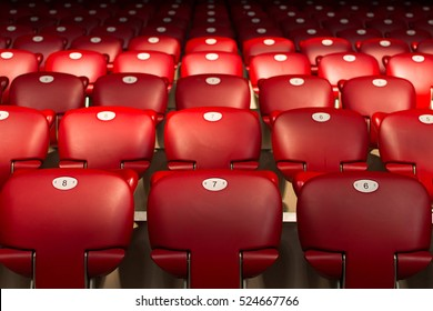Numbers On Empty Red Chairs