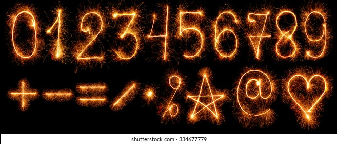 Numbers and other symbols of sparklers isolated on black background