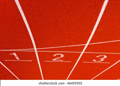 Numbers of a racetrack, on red tarmac, for runners