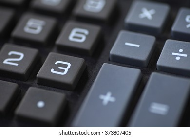 Numbers and symbols on a desk calculator