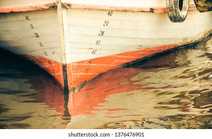 Numbers of waterline markings, indicating where the hull of a ship meets the surface of the water