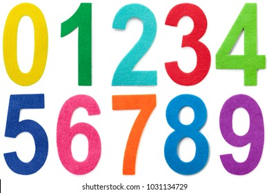 Numbers zero through nine in multi colored felt cutouts isolated on white background