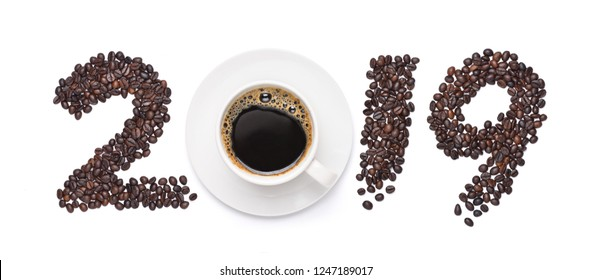 Numeral 2019 from coffee beans, paint brush style with white cup of coffee , isolated on white background