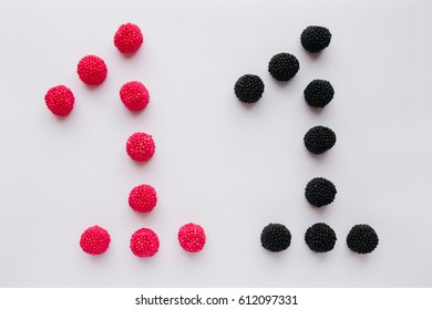 The numeral one is written in black and red on a white background. Figure lined with candy, marmalade, berries,  jelly