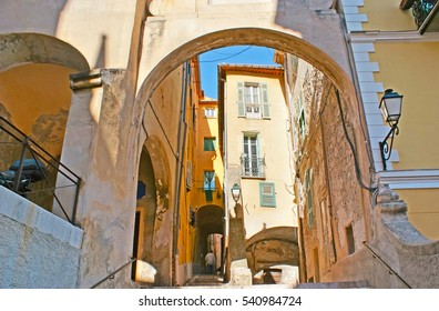 The numerous arched passes in Mattoni street, located in medieval part of town with preserved residential housing, Menton, France.
