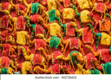 Numerous colorful hand made toy camels stocked up for sale in Rajasthan, India.