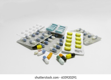 Numerous drug in different beautiful capsule color, Some drug is in package, isolated on the white background