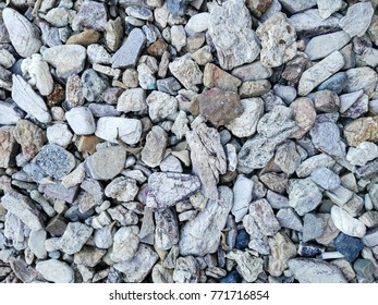 Numerous stones placed on the floor for abstract natural background images.
