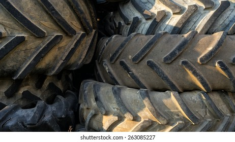 Numerous tires stacked on top of each other