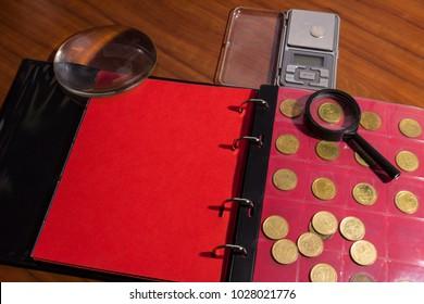 numismatic materials and album for coins - numismatic scene