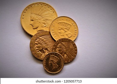 Numismatic at work shows some gold coins. Accessories are visible in the background.