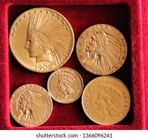 Numismatic at work shows some gold coins. Detailed view of an Indian gold coins collection. Ancient coins of the United States of America.