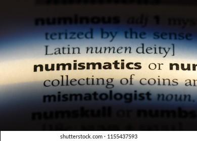 numismatics word in a dictionary. numismatics concept.