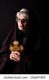 A nun holding a cross